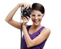 Girl hands professional photographic camera in spectacles isolated on white Royalty Free Stock Photo