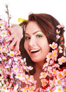 Girl with happy smile, spring flower and butterfly Royalty Free Stock Images