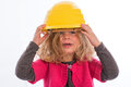 Girl with hardhat yellow is happy Stock Image