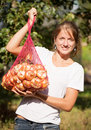 Girl with harvested onion Stock Image