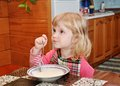 Girl has breakfast Royalty Free Stock Photo
