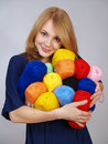 Girl has control over a lot of a color yarn Stock Photo