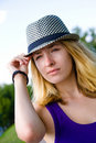 Girl in hat Stock Images