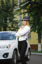 Girl in a hat on a background of white car Royalty Free Stock Photo