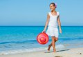 Girl with hat on the beach Stock Photography