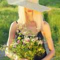 Girl In Hat With Flowers