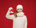 Girl in hat muffler and gloves with jingle bells christmas x mas winter happiness concept smiling Royalty Free Stock Photography