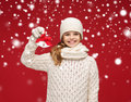 Girl in hat muffler and gloves with jingle bells christmas x mas winter happiness concept smiling Stock Image