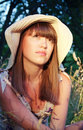 Girl in a hat on nature Stock Photo