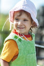 Girl in hat portrait of small beautiful cap against nature Royalty Free Stock Photo