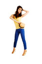 Girl with hat a pretty chinese woman in blue pants and a yellow top and high heels holding her straw on her hip for white Stock Photos