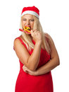 Girl in a hat santa helper eating candy cane emotionally Stock Image