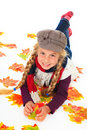 Girl with hat and scarf between autumn leaves Royalty Free Stock Photography