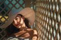 Girl with hat smiling in shade on a summer day Royalty Free Stock Images