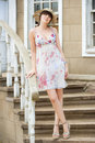 Girl in the hat and summer sundress on stairs Royalty Free Stock Photography