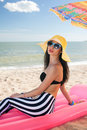 Girl have a rest at the beach stylish Royalty Free Stock Photo