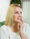 Girl having cunning look indoors smiling young on couch Stock Photography