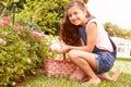 Girl having easter egg hunt in garden Stock Photos
