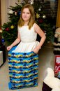 Girl having fun at Christmas tree standing in a large present bag Royalty Free Stock Photo