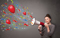 Girl having fun shouting into megaphone young with balloons and confetti Stock Photos