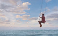 Girl having fun on swing Royalty Free Stock Photo