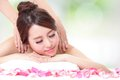 Girl having a massage for shoulder beautiful young with attractive face on resort green background asian woman Royalty Free Stock Photo