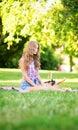 Girl having a picnic in park Royalty Free Stock Photo