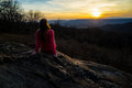 Girl having rest in mountains. Beautiful sunset in the mountains Royalty Free Stock Photo