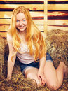 Girl on hayloft beautiful at summer day Royalty Free Stock Photo