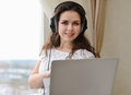 Girl with the head-phones working in a laptop Royalty Free Stock Photo