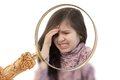 Girl with headache focus a magnifying glass on a little her hand held to her forehead painful expression showing Royalty Free Stock Image