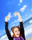 Girl with headphone on the beach portrait of red haired in cap Royalty Free Stock Images
