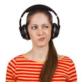 Girl with headphones expresses negative emotions cute Stock Images