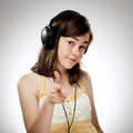 Girl with headphones on gray background Stock Photography