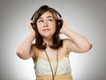 Girl with headphones on gray background Royalty Free Stock Photos