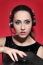 Girl in headphones holding a mouse Royalty Free Stock Image