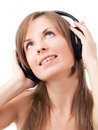 Girl with headphones listening to music Royalty Free Stock Images
