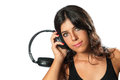 Girl with headphones listening to music horizontal isolated photo of a young and beautiful dj holding large her ear and Royalty Free Stock Photos