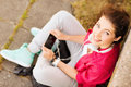 Girl with headphones listening to music summer holidays and teenage concept teenage outside Royalty Free Stock Photo