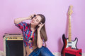Girl in headphones listens to music. electric. Royalty Free Stock Photo