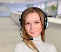 Girl with headphones in office answer the call Royalty Free Stock Photo