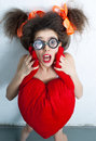 Girl with heart funny a red Royalty Free Stock Photography