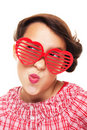Girl with heart shaped sunglasses Royalty Free Stock Photography
