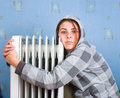 Girl and heater Stock Photos