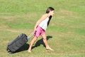 Girl with heavy suitcase Royalty Free Stock Image