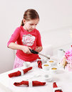 Girl helps to set table Royalty Free Stock Photography