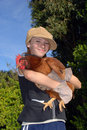 Girl with hen Stock Image