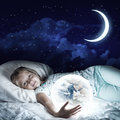 Girl in her bed and glowing globe Royalty Free Stock Photo