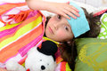girl in her bed has a headache Royalty Free Stock Photo