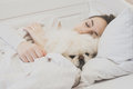 Girl and her dog in the bed. Royalty Free Stock Photo
